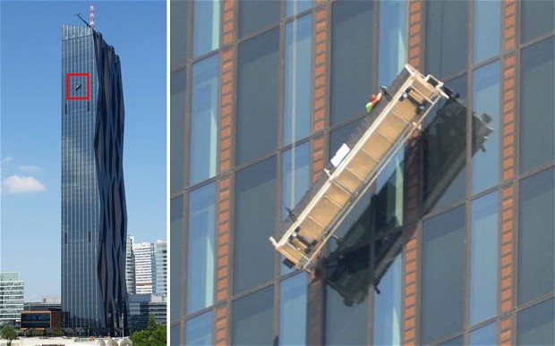 Two window cleaners were trapped 144 metres from the ground on the 48th floor in their platform on the DC Tower, Austria's highest skyscraper, in Vienna